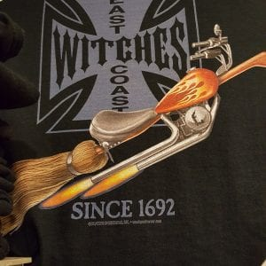 "A broom styled lika a motorcycle on a black background. Text reads ""east coast witches."""