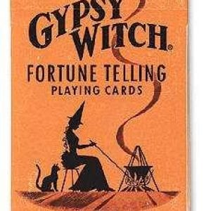 Playing cards with fortune telling instructions.