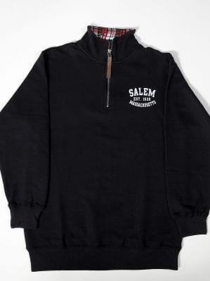 black half-zip sweatshirt.