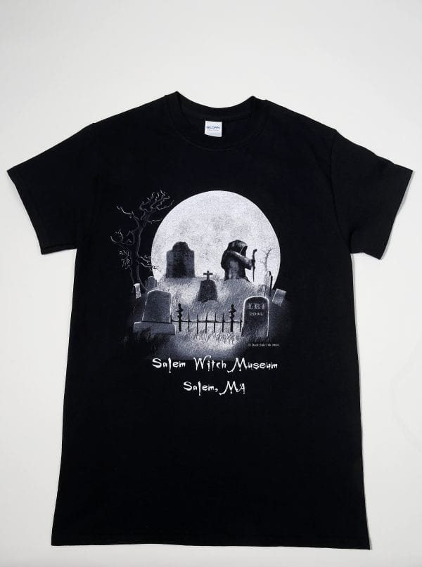 A black t-shirt with a graveyard scene arranged to look like a skull.