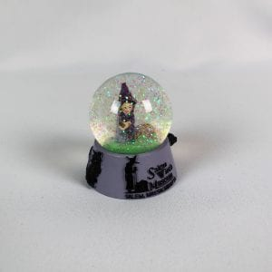 Purple witch snow globe