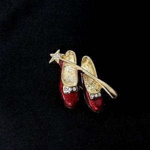 red shoes and wand brooch